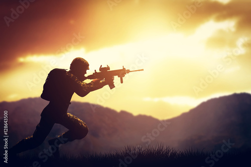 Fotografía  Soldier in combat shooting with his weapon, rifle