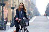 Fototapeta Miasto - Young woman on a bicycle. Piotrkowska, Łódź