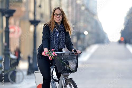 Young woman on a bicycle. Piotrkowska, Łódź