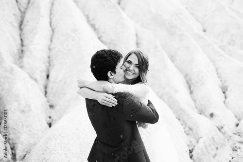 Fototapety, obrazy: beautiful and happy groom and bride hugging outdoors