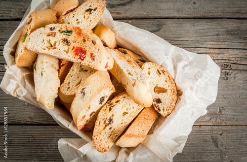 Slika na platnu Traditional Christmas baking biscotti or cantucci in a basket on a wooden table,
