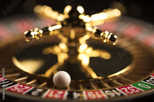 Casino theme. Golden roulette wheel closeup. плакат