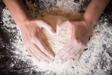 Female Hands Holding Dough In ...