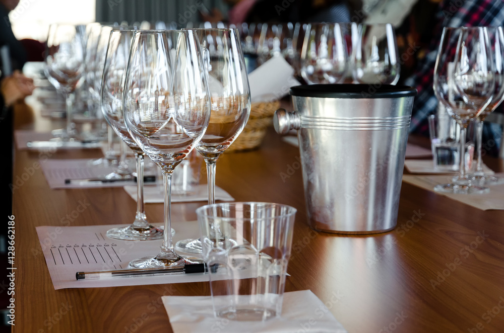 Table with glasses ready for wine tasting in a winery of Langhe (Italy)