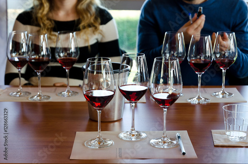 Valokuvatapetti Wine tasting experience in Langhe (Italy) with three glasses of Nebbiolo on a ta