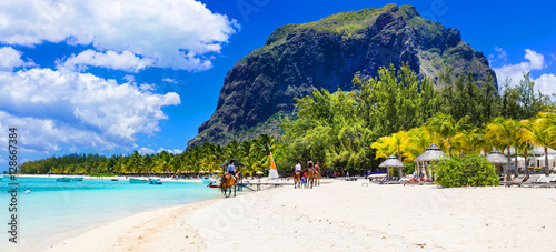 Fotobehang Eiland Stunning Le Morne in Mauritius. Horse riding on the beach