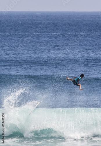 Male surfer takes a wipeout in Uluwatu, Bali, Indonesia