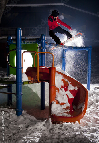 Foto op Canvas Wintersporten Snowboarder on a Playground