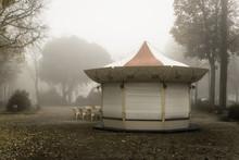 An Old Carousel Close Shrouded In The Fog