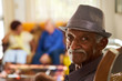 canvas print picture - Senior Black Man With Hat Looking At Camera In Hospice