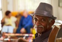 Senior Black Man With Hat Look...
