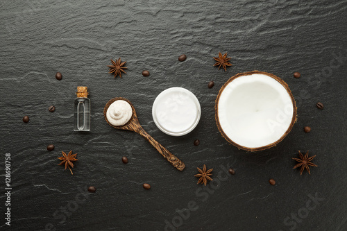 Wall Murals Cafe Homemade spa products. Half coconut shell, coffee and anise on b
