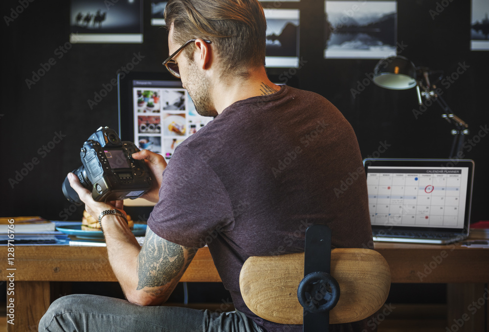 Fototapety, obrazy: Photographer Working Checking Photo Concept