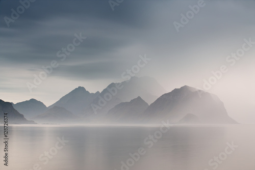 Summer cloudy Lofoten islands. Norway misty fjords.