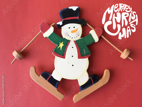 Poster de jardin Chambre bébé Snowman and Merry Christmas word on red background