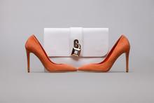 Orange Women's High-heeled Shoes With Handbag On A Grey Background