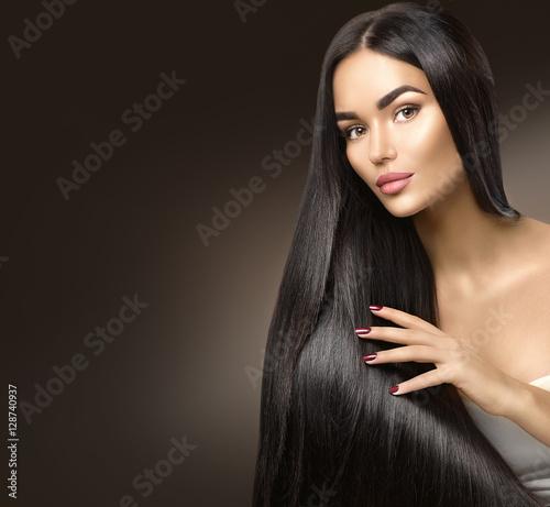 Beautiful long hair. Beauty model girl touching healthy hair