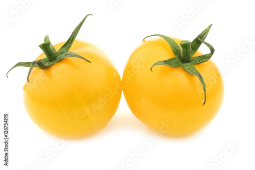 fresh dutch yellow tasty tom tomatoes on a white background Wallpaper Mural