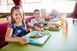 canvas print picture - Children eating at the canteen