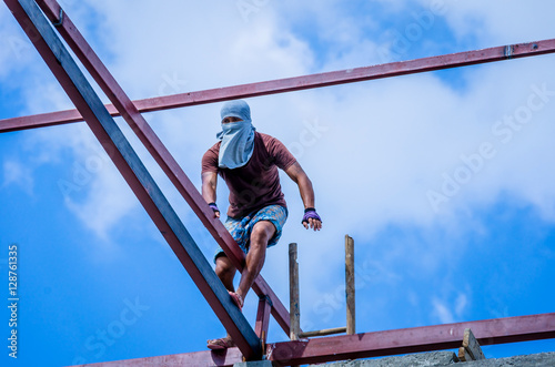 Fotografie, Obraz  Construction workers working on high risk