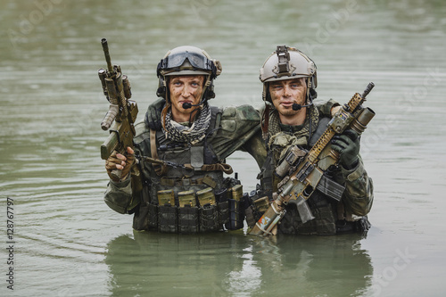 Photo  Military team crossing the river under fire