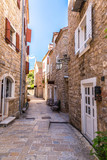 Fototapeta Uliczki - Narrow street in old town in Budva