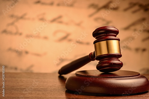 Photo  Wooden gavel on a plinth