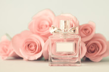 Vintage Perfume Bottle And Pink Roses