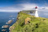 Fototapeta Sypialnia - Mykines island, Faroe Islands, Denmark. Lighthouse and cliffs.