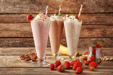 Delicious Milkshakes On Wooden Background