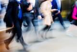 crowd of walking people in motion blur - 128816195