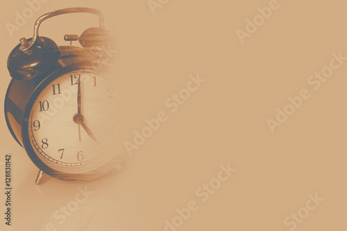 lost time memory, retro clock time at 7 o'clock with fade dissolve missing life history concept Fototapet