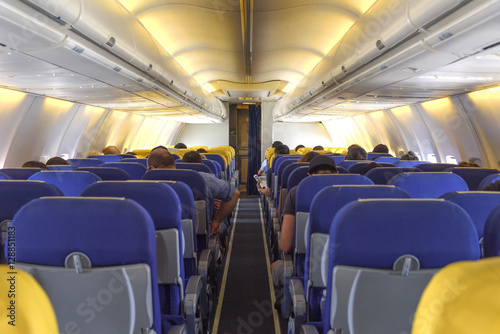 Poster Avion à Moteur Interior passenger cabin with seats on the airplane