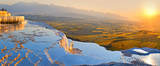 Panorama terraces from travertine in Pamukkale at sunset.