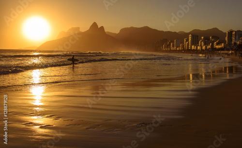 In de dag Rio de Janeiro Golden sunset with Two Brothers (Dois Irmaos) Mountain and surfer silhouette at Ipanema Beach, Rio de Janeiro, Brazil