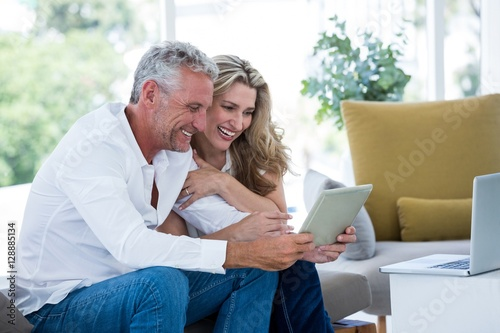 Fotografie, Obraz  Smart mature couple using digital tablet