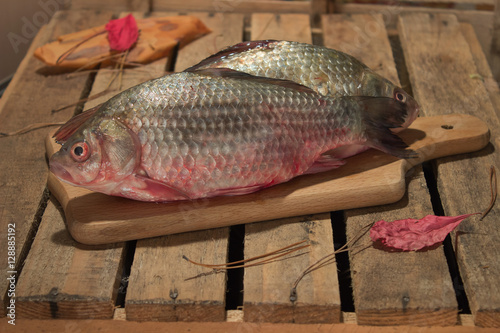 Raw Fish Carp On A Kitchen Cutting Board With Red Eyes Buy This Stock Photo And Explore Similar Images At Adobe Stock Adobe Stock