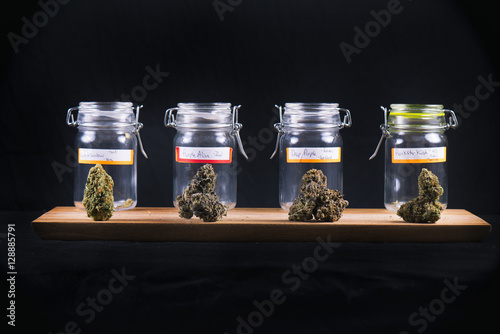 Assorted cannabis bud strains and glass jars - medical marijuana Tapéta, Fotótapéta