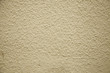 A full page of cream rendered wall background texture