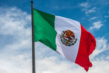 Flag Of Mexico Over Blue Cloud...