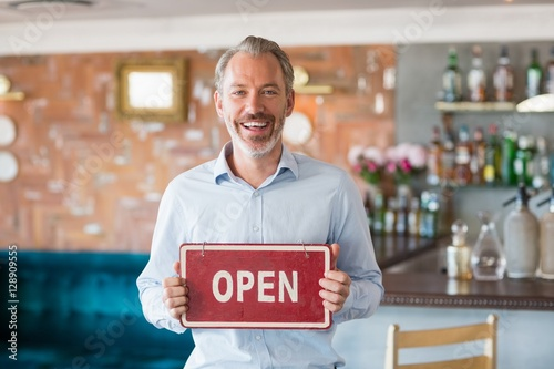 Poster Positive Typography Portrait of man showing signboard with open sign