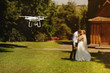 canvas print picture - dron filming a wedding couple
