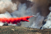 White Aircraft Dropping Fire R...
