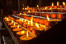 Group Of Votive Candle In A Ch...