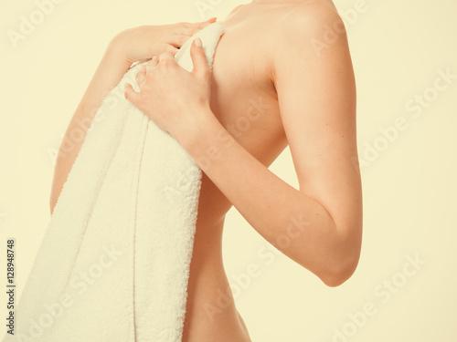 Fototapeta Woman covering breast under towel. obraz na płótnie