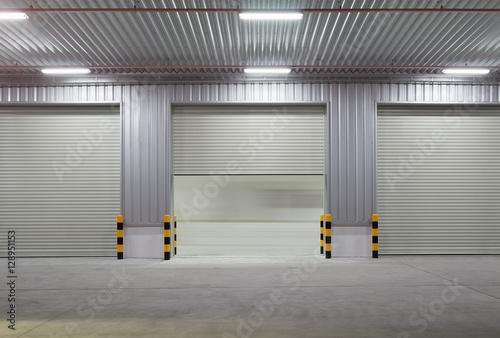 Staande foto Industrial geb. Shutter door or roller door and concrete floor outside factory building use for industrial background.