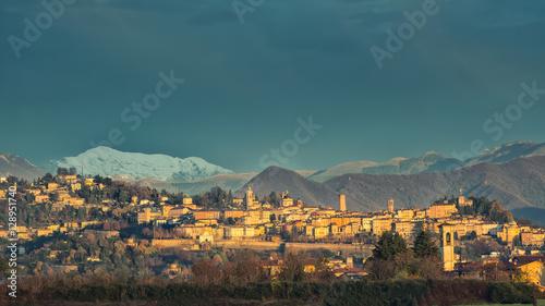 Photo  Bergamo Alta .with snow in the mountains