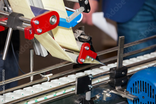 Fotografie, Obraz  Labeling product machine in food industry