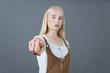 blonde school girl in corduroy sundress chooses you sign studio