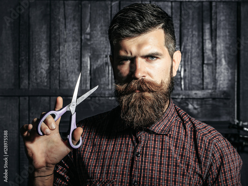 Fotografering bearded man barber with scissors